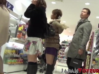 Asian stunners filmed up miniskirt in store