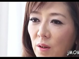 Charming asian mature plays with water on her juicy pussy